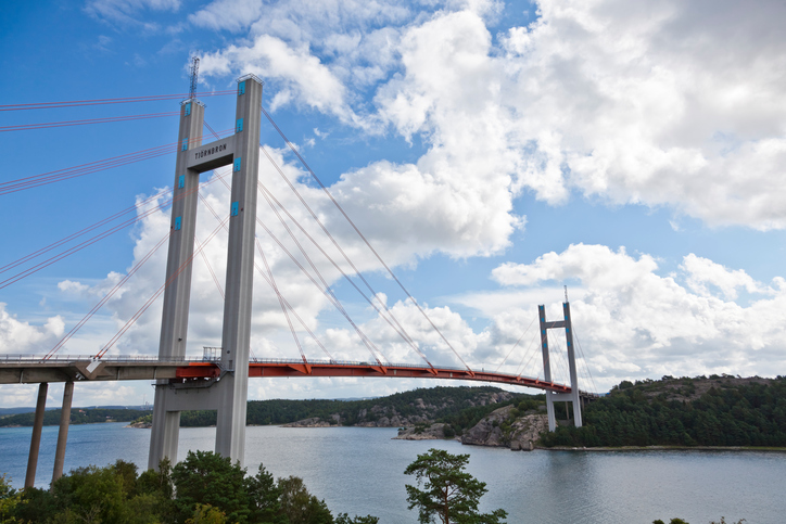 """The Tjorn Bridge in Sweden connects Stenungsund on mainland Sweden with the island Tjorn on the western coast of the country. The length is 664 m, the span width is 366 m, and the height above the water is 45 m.Inaugurated in 1981, the bridge was built in record time after its predecessor, the Almo Bridge, which had been inaugurated in June 1960, collapsed after the Tanker Star Clipper collided with it on 18 January 1980 in fog and darkness. Eight people died in 7 vehicles that plunged into the sea before the bridge could be closed. The base of the old bridge can just be seen on the far side.Adobe RGB 1998 profile."""